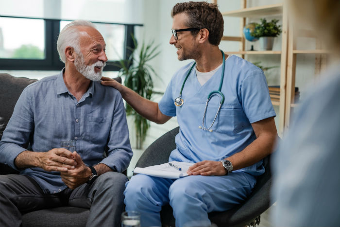 Man meets with a doctor for a stem cell therapy consult
