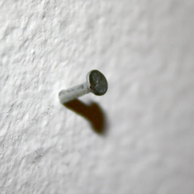 Image result for nail in wall
