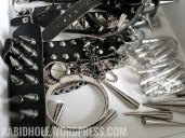 Spikes, studs, a cross and one handcuff bracelet.