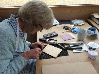 Diana cutting her block