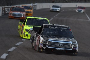 Erik Jones, driver of the #4 Special Olympics World Games Toyota, leads Matt Crafton, driver of the #88 Ideal Door/Menards Toyota, during the NASCAR Camping World Truck Series WinStar World Casino & Resort 400 at Texas Motor Speedway on June 5, 2015 in Fort Worth, Texas. (Photo by Rainier Ehrhardt/Getty Images for Texas Motor Speedway)