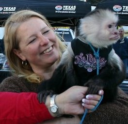 Buying a program from Mikey the Monkey at Texas Motor Speedway.