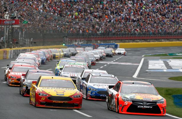 CHARLOTTE, NC - MAY 29: Martin Truex Jr., driver of the #78 Bass Pro Shops/Tracker Toyota, and Joey Logano, driver of the #22 Shell Pennzoil Ford, lead the field to the green flag to start the NASCAR Sprint Cup Series Coca-Cola 600 at Charlotte Motor Speedway on May 29, 2016 in Charlotte, North Carolina. (Photo by Brian Lawdermilk/Getty Images)