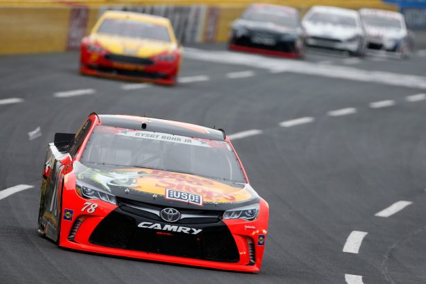 Martin Truex Jr., driver of the #78 Bass Pro Shops/Tracker Toyota, leads a pack of cars during the NASCAR Sprint Cup Series Coca-Cola 600 at Charlotte Motor Speedway on May 29, 2016 in Charlotte, North Carolina. (Photo by Brian Lawdermilk/Getty Images)