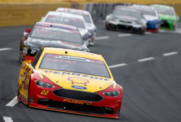 Joey Logano, driver of the #22 Shell Pennzoil Ford, leads a pack of cars during the NASCAR Sprint Cup Series Coca-Cola 600 at Charlotte Motor Speedway on May 29, 2016 in Charlotte, North Carolina. (Photo by Brian Lawdermilk/Getty Images)