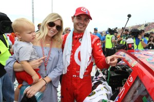 Kyle Larson, driver of the #42 Target Chevrolet, girlfriend Katelyn Sweet and son Owen Larson affixe the winner's decal to his car in Victory Lane after winning the NASCAR Sprint Cup Series Pure Michigan 400 at Michigan International Speedway on August 28, 2016 in Brooklyn, Michigan. (Photo by Brian Lawdermilk/NASCAR via Getty Images)