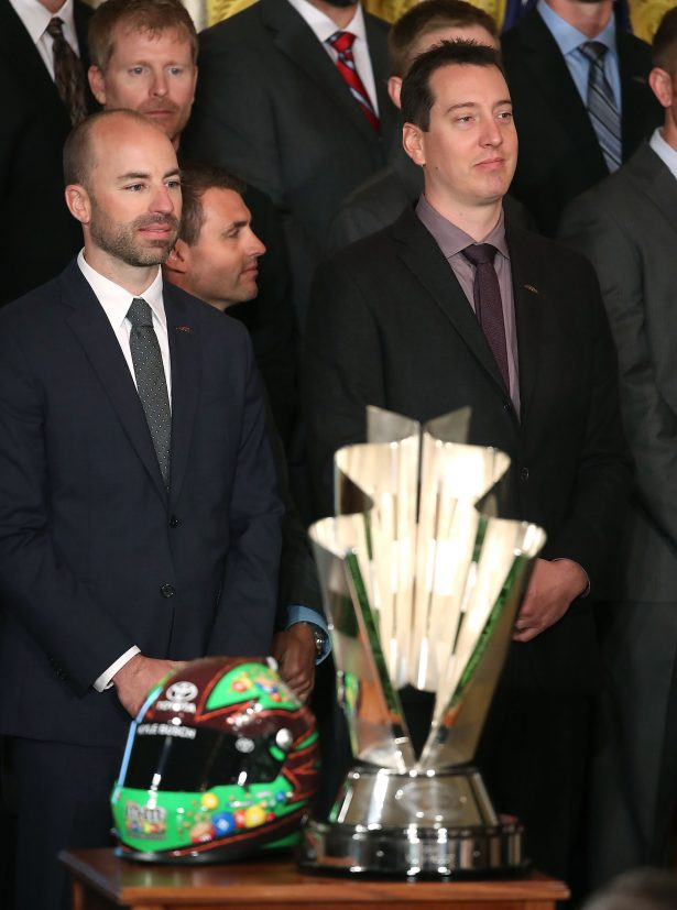 Sprint Cup Champion Kyle Busch, (R), and Crew Chief Adam Stevens (L), listent to President Barack Obama speak during an event in the East Room at the White House, September 28, 2016 in Washington, DC. President Obama hosted the event to honor Kyle Busch and the Joe Gibbs Racing #18 car for their 2015 NASCAR Sprint Cup Series championship. (Photo by Mark Wilson/Getty Images)
