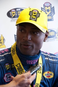 Antron Brown talks to the media after winning the AAA Texas NHRA FallNationals Top Fuel race on Sunday at the Texas Motorplex. Photo by Mark Broughton / bam photo