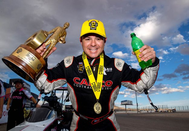 To the victor go the spoils. Steve Torrence shows off the hardware he collected after winning Sunday's 16th annual Toyota Nationals at Las Vegas. Photo by Mark Rebilas