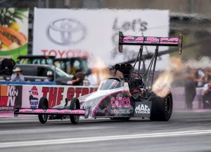 "Steve Torrence drives the ""Breast Cancer Awareness"" version of the Capco Contractors/Rio Ammunition Top Fuel dragster to victory Sunday in the 16th annual Toyota Nationals at Las Vegas. Photo by Mark Rebilas"