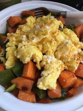 Scrambled Eggs Over Sweet Potato Hash