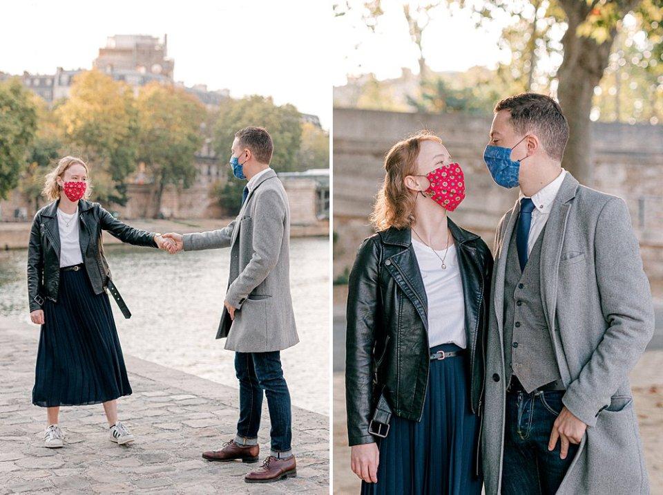 Masked ex-pat couple dancing along the Parisian Seine River