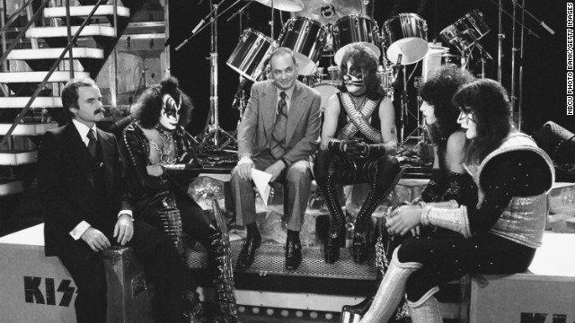 """NBC REPORTS -- """"The Land of the Hype & Glory"""" -- Pictured: KISS manager Bill Aucoin, KISS' Gene Simmons, NBC News' Edwin Newman, KISS' Peter Criss, Paul Stanley, Ace Frehley -- (Photo by:NBC/NBCU Photo Bank)"""