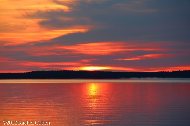Shimmering sunrise on Lake Huron with Mackinac Island in silhouette.