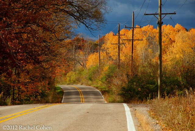 Gorgeous fall foliage on a beautiful winding rural road.