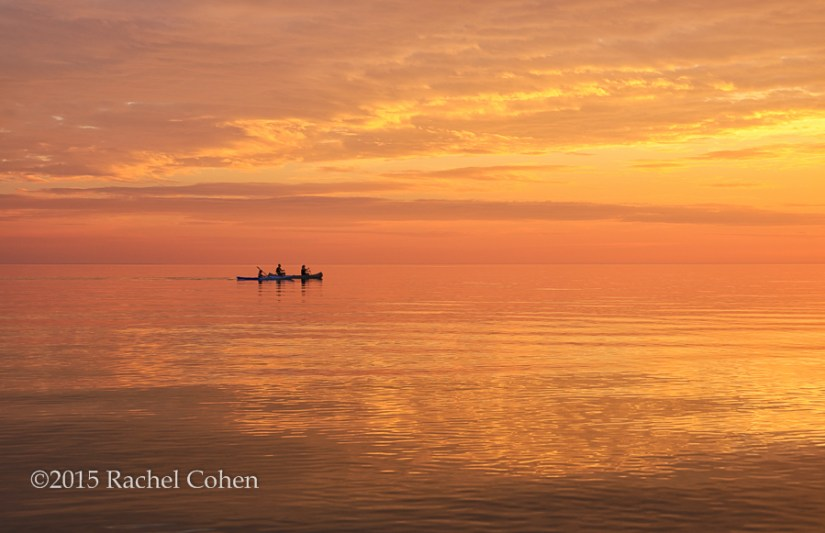 """Life is But a Dream"" This was one special sunset on Lake Michigan! The waters were like glass, and the whole world seemed alive with the colors of sunset. There were several people kayaking and canoeing on the smooth water! Dreamy!"