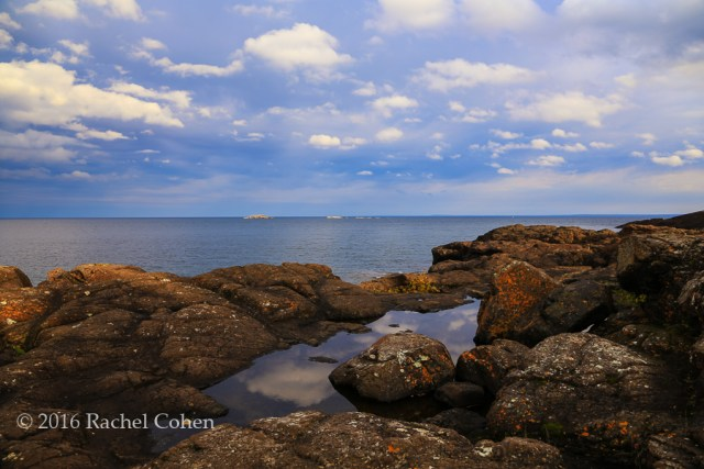 """Presque Isle Reflections"" Beautiful clouds reflected in the pools of water on the rocks at Presque Isle Park."