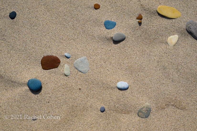 """""""Sand and Stones Random""""  Beautiful and colorful beach stones in the sand along Lake Michigan!"""