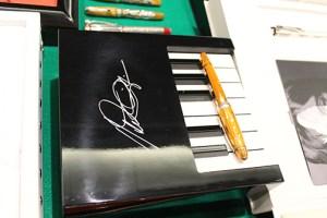 Pen on a piano box