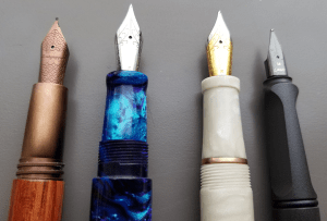 Four different fountain pens with different grip styles