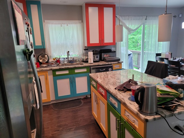 Side view of kitchen and island with painted cabinets