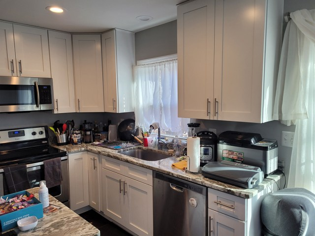 Side view of kitchen with unpainted cabinets