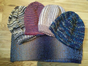 A selection of hats and a scarf for Knit for Peace ©Rachel Gibbs