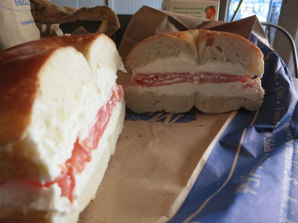 close-up of a plain bagel with cream cheese and lox