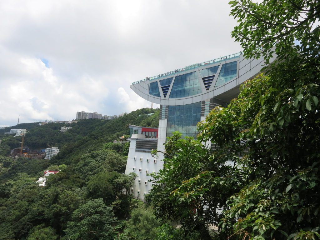 anvil-shaped building with a huge roof on Victoria Peak