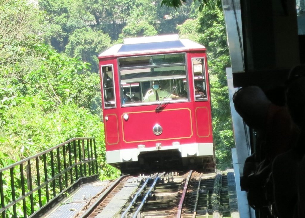 shows the old-fashioned red tram car on Victoria Peak