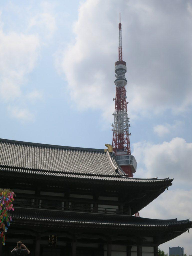 Tokyo Tower visible behind Zojoji temple in Shiba Park