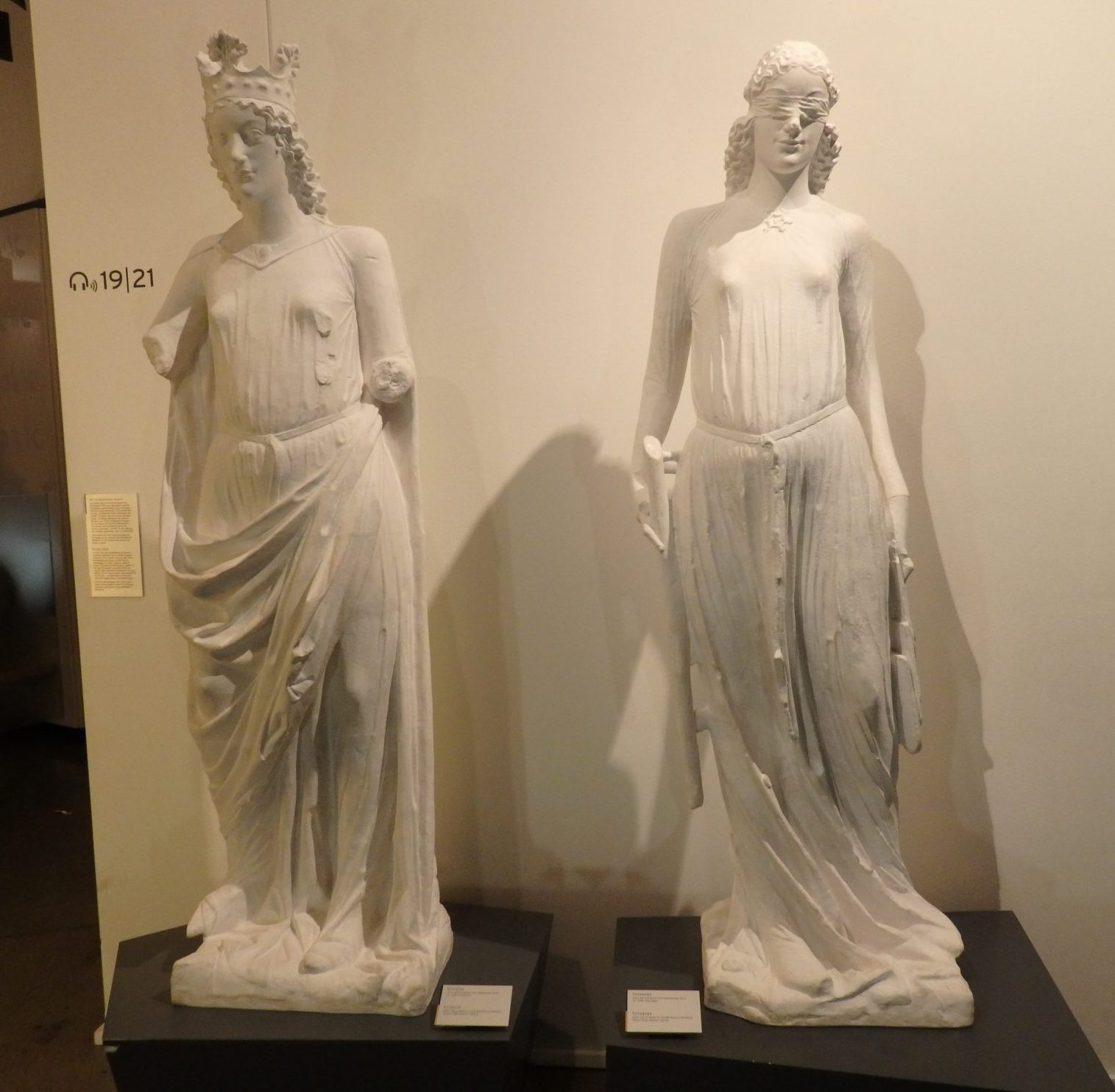 """medieval statues. According to the museum sign, Synagoga, right, representing Judaism, is """"blind to salvation and thus inferior to her rival Ecclesia, left, who symbolized the Church."""" Shows Christian attitudes toward Jews in the Middle Ages."""
