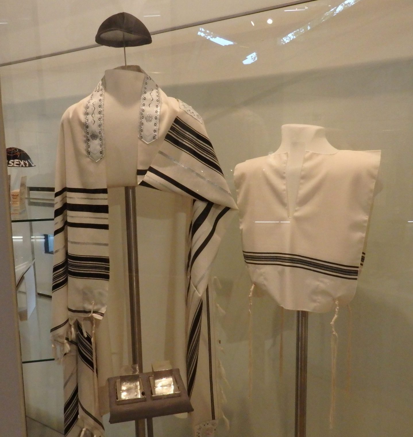 Jewish prayer shawls, called tallit. The museum includes explanations of Jewish culture and tradition, as well as tracing how it changed over time. Jewish Museum Berlin