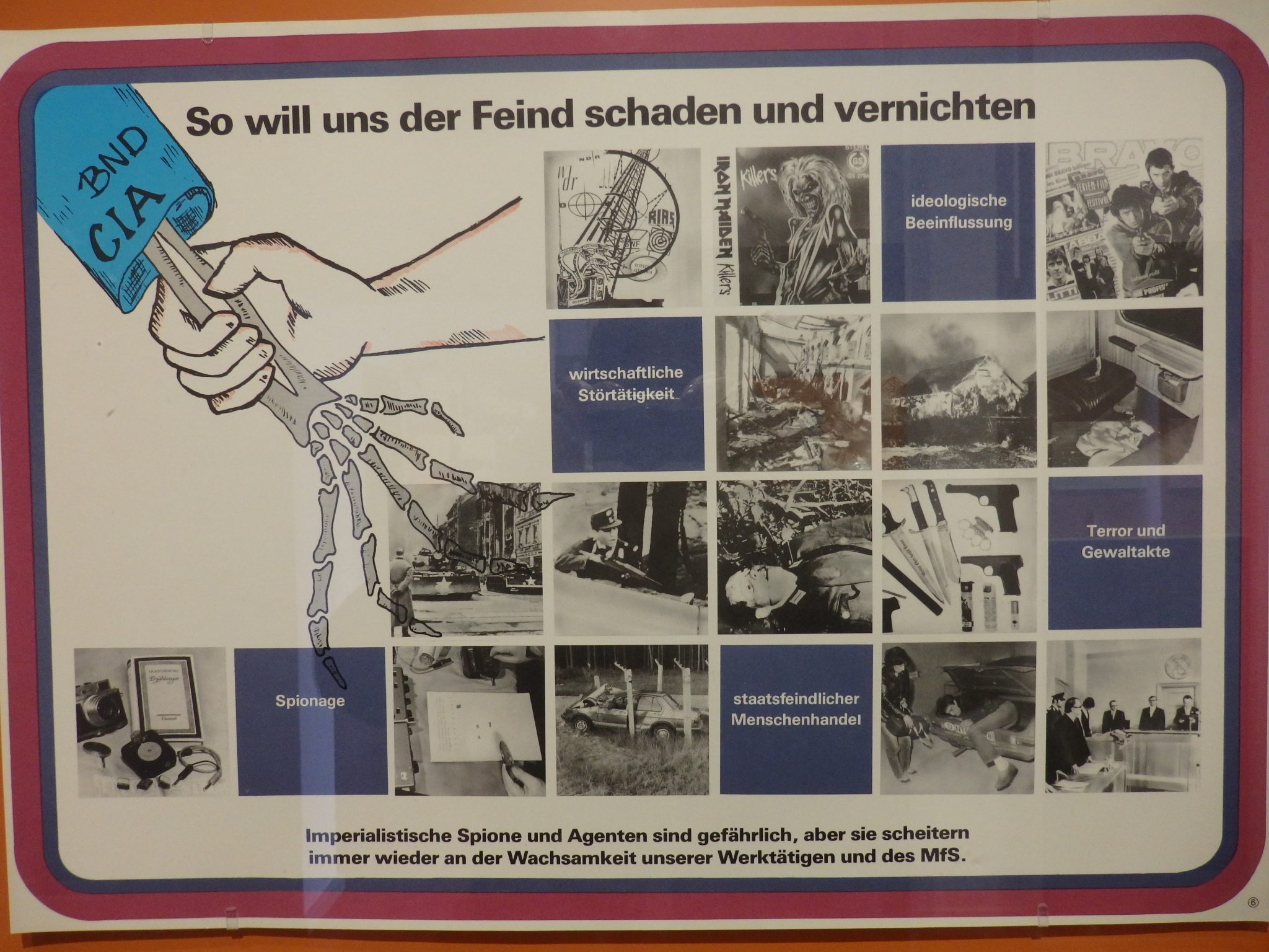 "This training poster from the Stasi Museum says ""This is how the enemy wants to harm and destroy us."""