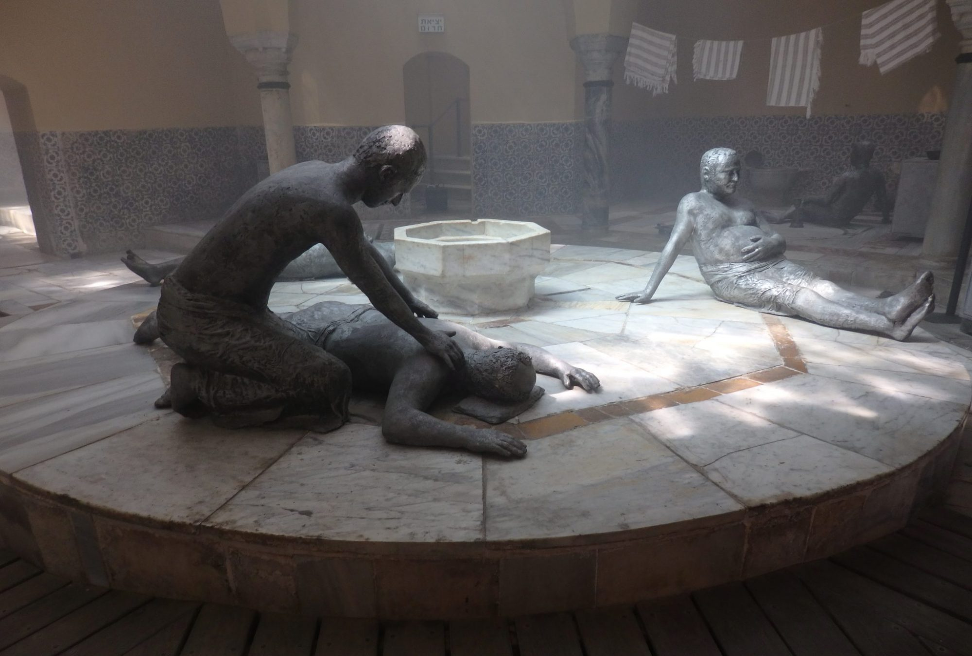 Inside the Turkish bathhouse in Akko old city, statues show what it might have looked like as men enjoyed the steambath or got a massage.