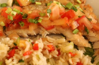 Baikal omul fish served with rice and vegetables in a local restaurant