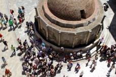 Tour groups gather around Onofrio's Fountain at one of the city's main gates