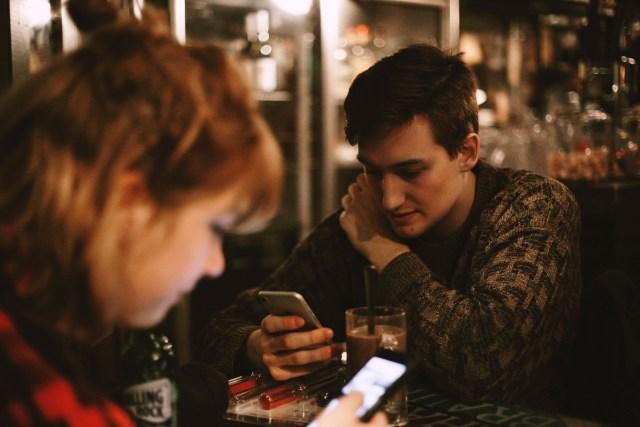 on phones in cafe Free Unsplash