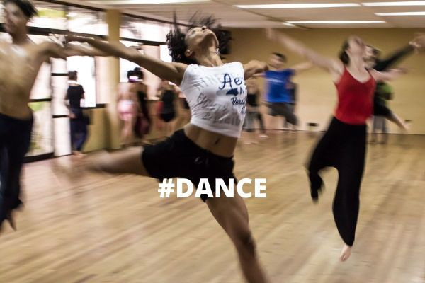 Several people leaping around a room, on top is the word Dance in white writting