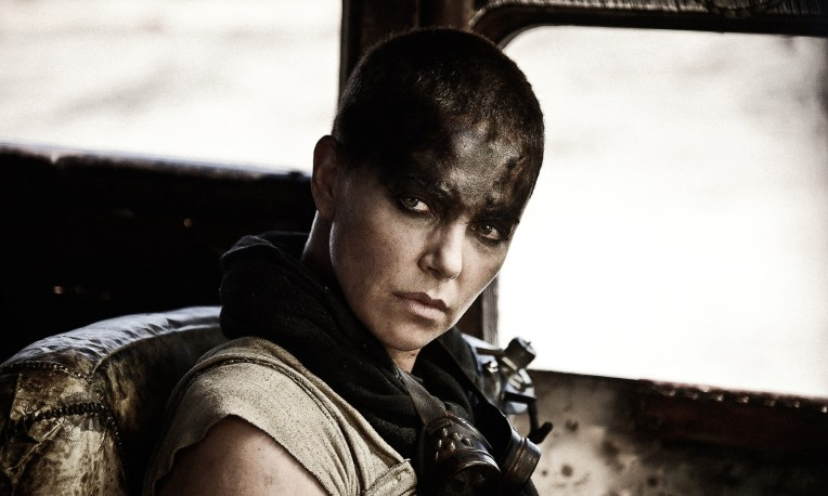 "This photo provided by Warner Bros. Pictures shows Charlize Theron as Imperator Furiosa in Warner Bros. Pictures' and Village Roadshow Pictures' action adventure film, ""Mad Max: Fury Road,"" a Warner Bros. Pictures release. (Jasin Boland/Warner Bros. Pictures via AP)"