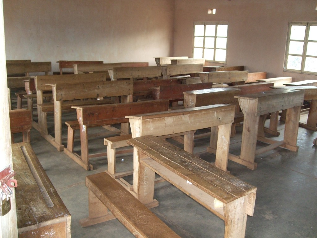 a typical classroom -- generally 3 students sit at each desk