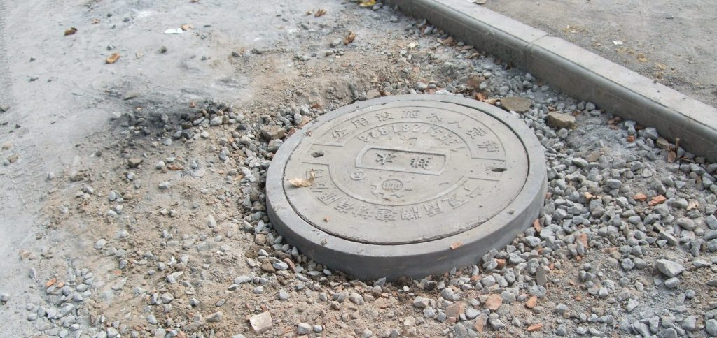 The offending manhole was closed by the time we went back to see it in the daylight the next day.