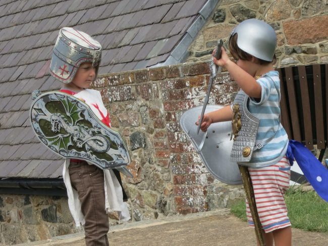 children playing as medieval knights