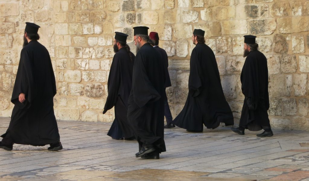 priests -- Greek Orthodox, I think -- spotted outside the Church of the Holy Sepulchre, on the Via Dolorosa