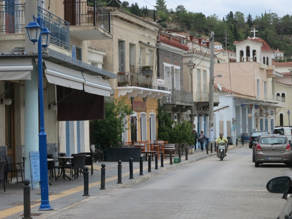 a view of the street along the water on Poros