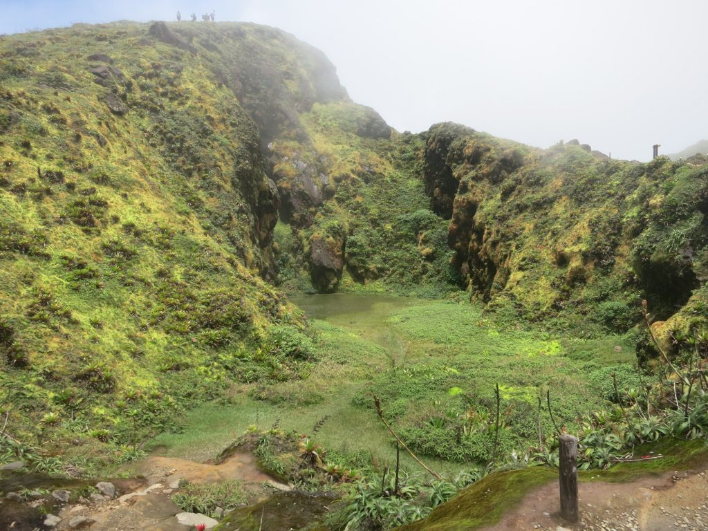 a view down into the green side of the crater of La Soufriere volcano