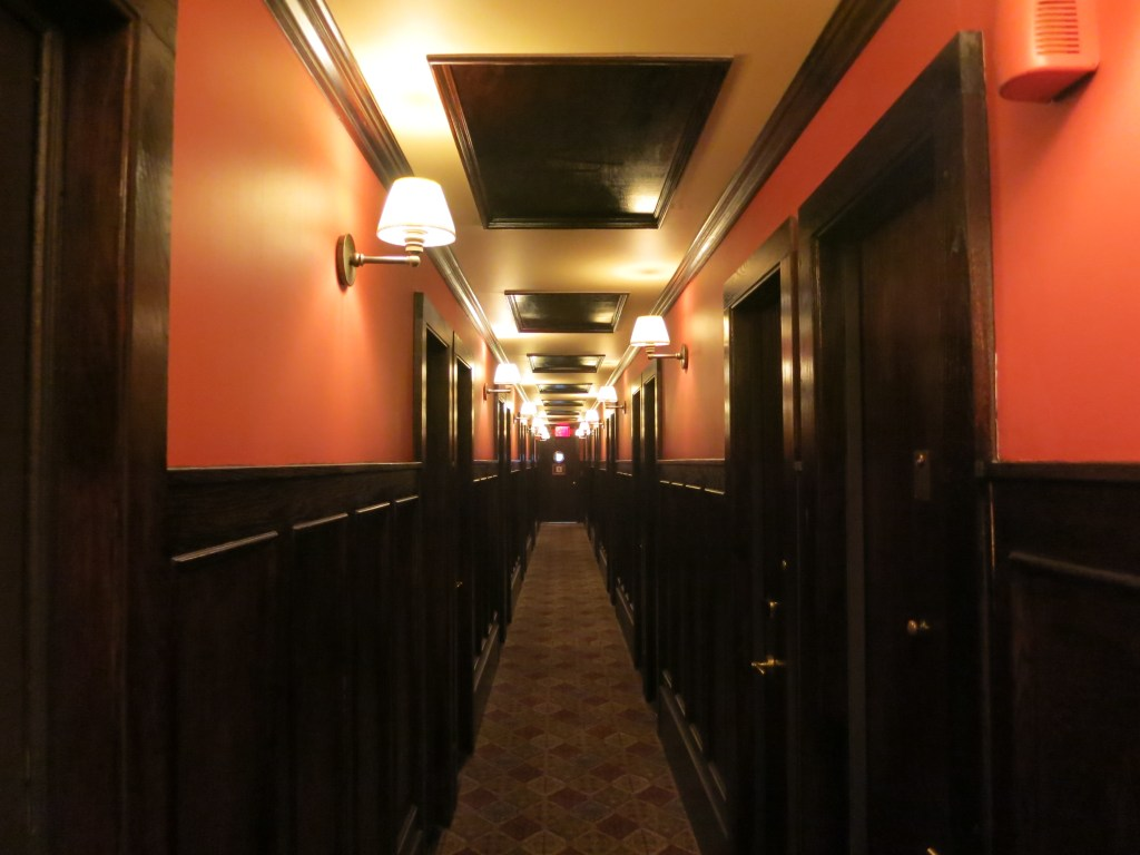 a view down a hallway in the Jane Hotel, very much resembling a ship's hallway