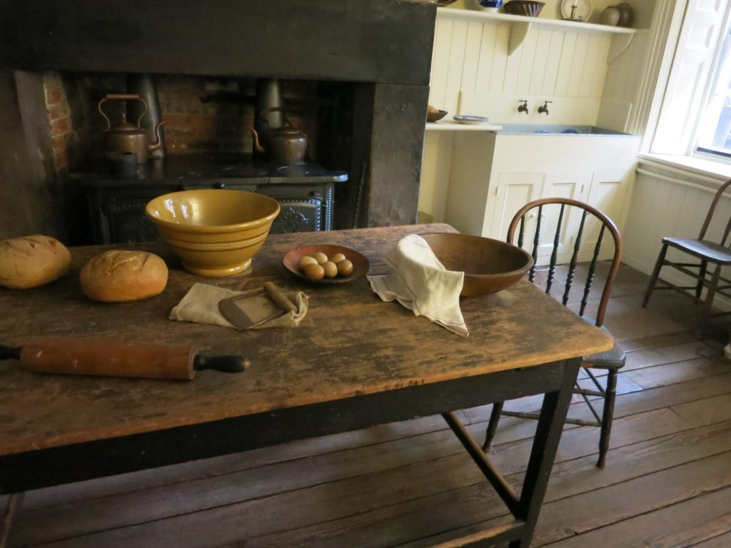 in Merchant's House Museum, a view of the kitchen showing the worktable and the oven hearth behind it