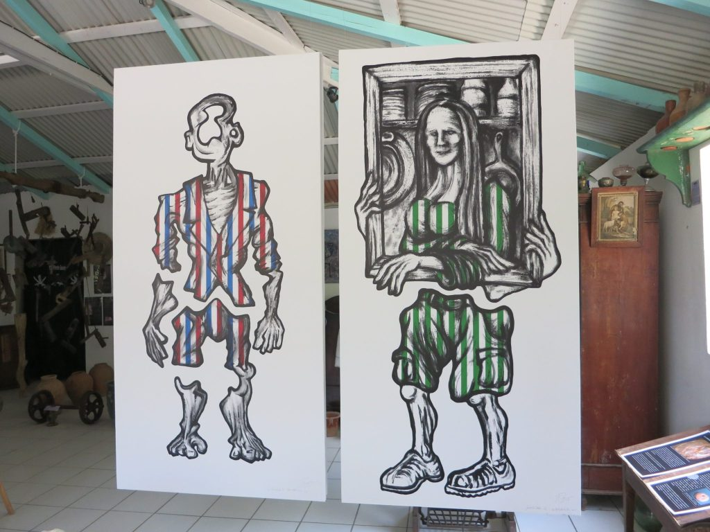 Two paintings of fragmented human forms in Kreol West Indies
