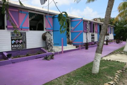 the purple and blue painted exterior of Kreol West Indies